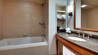 hotel bathroom with vanity and bathtub