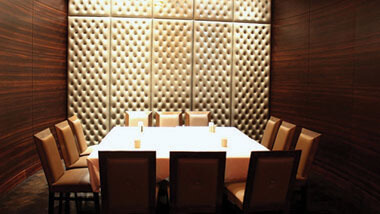 A rectangular table set for 12 in a private banquet area at Hollywood Casino in St. Louis, Missouri.