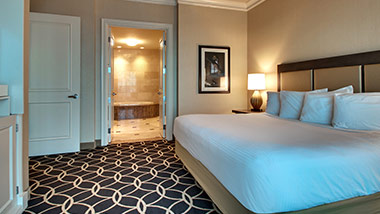 hotel suite with king bed and master bathroom