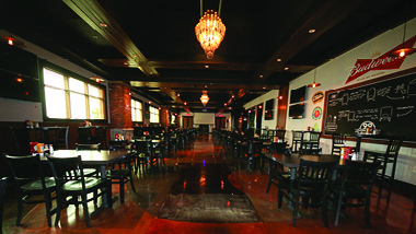 4-top tables at 99 Hops House with chandelier