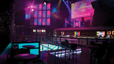 The light-up dance floor and walls and bar inside Boogie Nights night club at Hollywood Casino in St. Louis, Missouri.