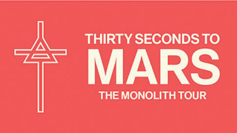"The words ""Thirty Seconds to Mars: The Monolith Tour"" in off-white on a pale red background next to an image of a cross with a triangle overtop."