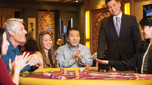 Players cheer a win in the Phat Tai gaming room at Hollywood Casino in St. Louis, Missouri.
