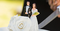 A wedding cake topper showing the bride and groom.