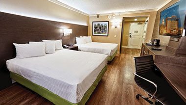 Two queen-size beds inside a hotel room at Hollywood Casino hotel in St. Louis, Missouri.