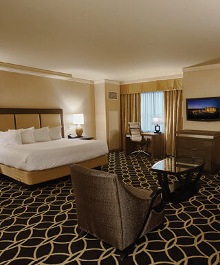 The king-size bed and sitting area inside the Rodeo Jr. Suite at Hollywood Casino hotel in St. Louis, Missouri.
