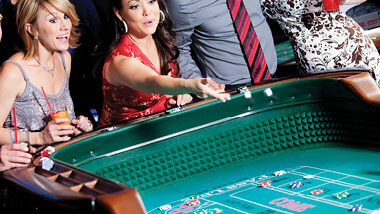 Woman throwing dice at craps table