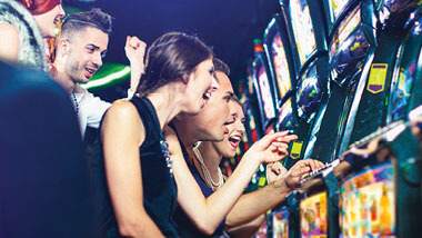 group of friends playing slots