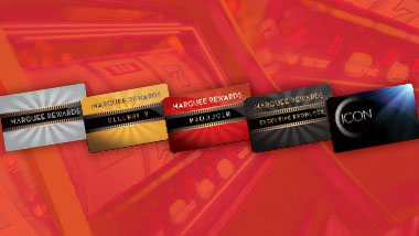 Different tier level Marquee Rewards cards are shown on a red background that features a shaded out classic slot machine.